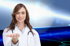 Portrait of female nurse holding out open palm Royalty Free Stock Photo