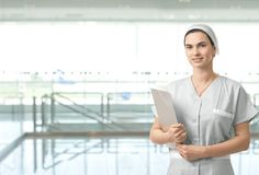 Portrait of female nurse on hospital corridor Royalty Free Stock Photography