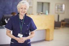 Portrait Of Female Nurse In Hospital Reception Royalty Free Stock Photo