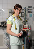 Portrait female nurse in ICU in green uniform with breathing bag Stock Photos
