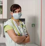Portrait female nurse in ICU in green uniform with protective ma Royalty Free Stock Images