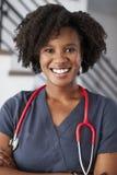 Portrait Of Female Nurse Wearing Scrubs In Hospital stock photo