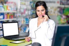 Portrait of a female operator with headphones stock photos