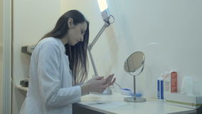 Portrait of a female ophthalmologist cleaning contact lens stock video footage