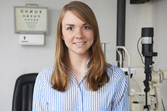 Portrait Of Female Optician In Optometrists. Smiling Female Optician In Optometrists Stock Image