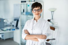 Portrait of female optometrist at eyesight medical clinic. Portrait of female optometrist at eyesight medical ophthalmology clinic stock image