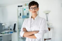 Portrait of female optometrist at eyesight medical clinic Stock Photography