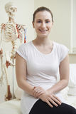 Portrait Of Female Osteopath In Consulting Room Royalty Free Stock Photos