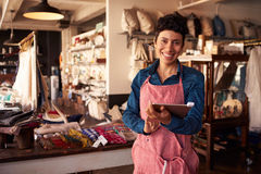Portrait Of Female Owner Of Gift Store With Digital Tablet stock image