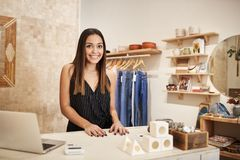 Portrait Of Female Owner Of Independent Clothing And Gift Store Behind Sales Desk stock photo