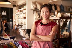 Portrait Of Female Owner Standing In Gift Store Stock Images