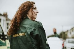 Portrait of female paramedic in uniform royalty free stock image