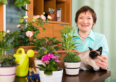 Portrait of female pensioner with decorative plants Royalty Free Stock Photos