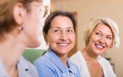 Portrait of female pensioners indoor Stock Images