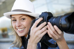 Portrait of female photographer Stock Images