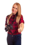 Portrait of a female photographer gesturing thumbs up over white Royalty Free Stock Photography