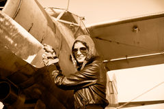 Portrait of female pilot  with plane propeller Royalty Free Stock Image