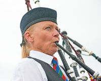 Portrait of a female Piper. In traditional  costume marching and playing in the Forres Highland Games held on 6th July 2013 Stock Photo