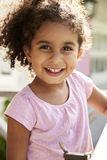 Portrait Of Female Pupil Outside Classroom At Montessori School Stock Photos