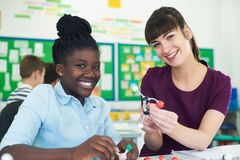 Portrait Of Female Pupil And Teacher Using Molecular Model Kit I. Female Pupil And Teacher Using Molecular Model Kit In Science Lesson Royalty Free Stock Photography