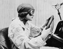 Portrait of female racecar driver Stock Photos