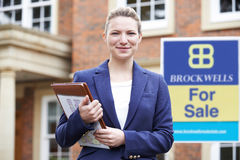 Portrait Of Female Realtor Standing Outside Residential Property Royalty Free Stock Photography