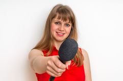 Portrait of female reporter with black microphone. Journalism and broadcasting concept Stock Image