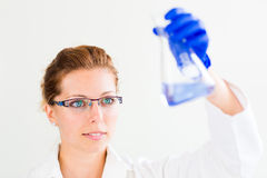 Portrait of a female researcher carrying out research in a chemi Royalty Free Stock Photo