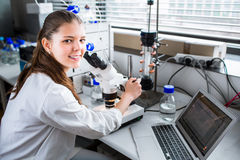 Portrait of a female researcher carrying out research in a chemistry lab Stock Images