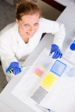 Portrait of a female researcher doing research in a lab Royalty Free Stock Photography