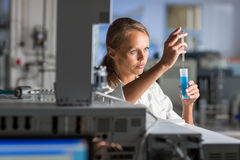 Portrait of a female researcher doing research in a lab Royalty Free Stock Photo