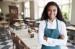 Portrait Of Female Restaurant Manager In Empty Dining Room royalty free stock photos