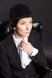 Portrait of female rider in black armchair Royalty Free Stock Images