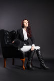 Portrait of female rider in black armchair Royalty Free Stock Photo