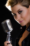 Portrait of female rocksinger with microphone Royalty Free Stock Photos