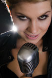Portrait of female rocksinger with microphone Royalty Free Stock Photo