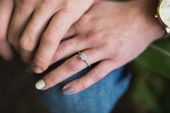 Portrait of female`s engagement ring stock photo