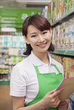 Portrait of Female Sales Clerk in a Supermarket Stock Photo
