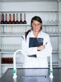 Portrait of a female scientist holding a clipboard Royalty Free Stock Images