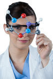 Portrait of female scientist holding molecular model Royalty Free Stock Images