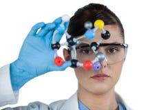 Portrait of female scientist holding molecular model Royalty Free Stock Photo