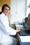 Portrait of a female scientist with a monitor Royalty Free Stock Photography