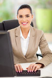 Female secretary typing Royalty Free Stock Images