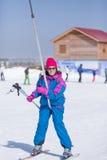 Portrait of female skier on stirrup Royalty Free Stock Photography