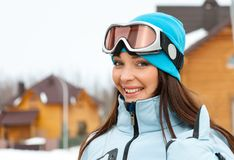 Portrait of female skier thumbing up Stock Image