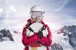 Portrait of a female snowboarder back against sunlight in mountains panorama Royalty Free Stock Images