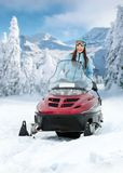 Portrait of female on snowmobile Stock Photos