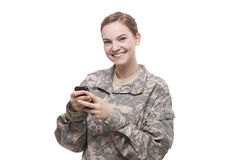 Portrait of female soldier text messaging Royalty Free Stock Photos