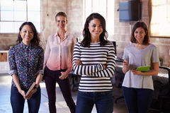 Portrait Of Female Staff Standing In Modern Design Office Royalty Free Stock Image