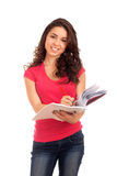 Portrait of female student with books Royalty Free Stock Photography